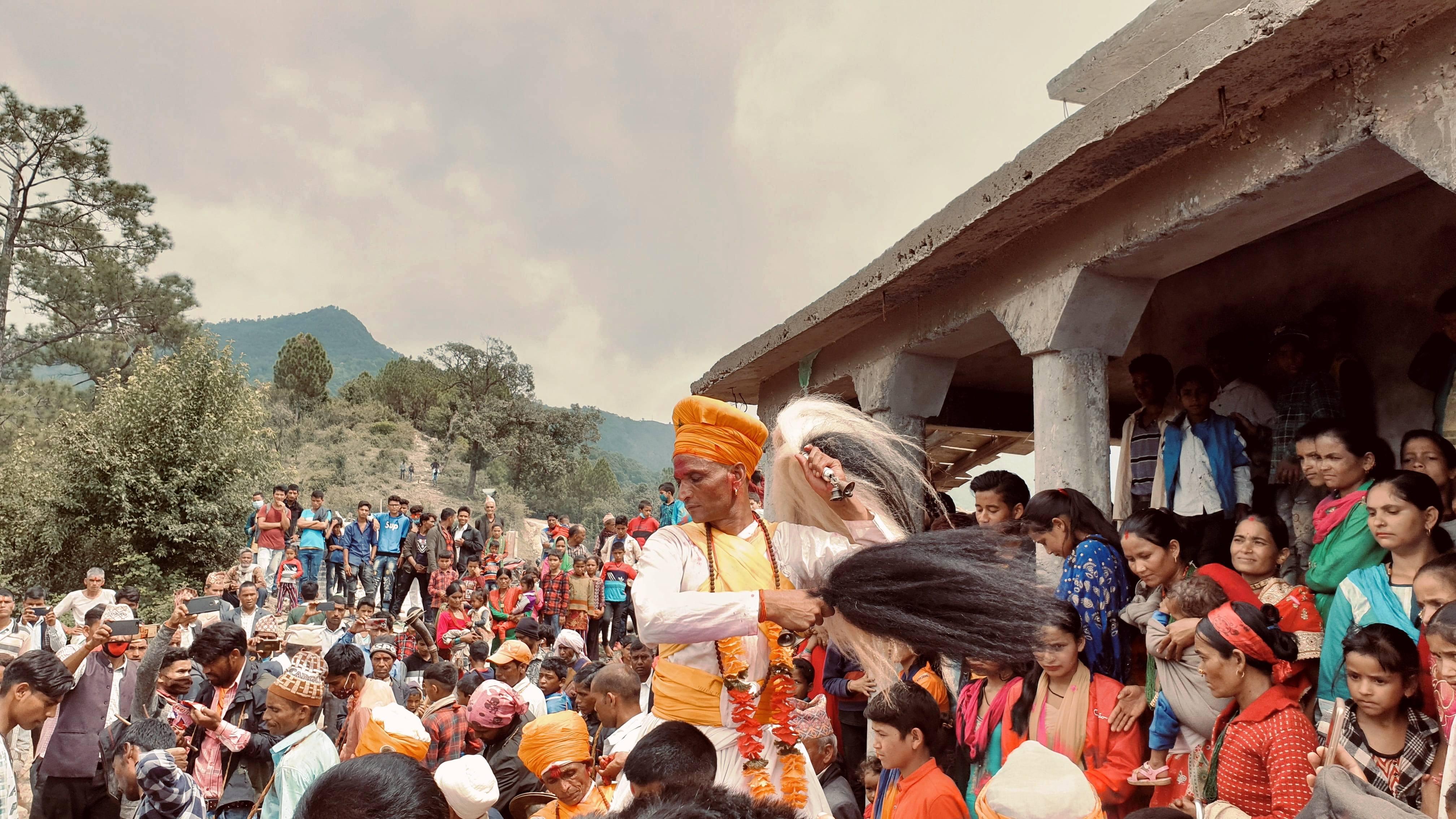 A main priest (Mul Dhaami) worshipping Bandali God by performing rituals during Shrawan Poornima (full moon day in Shrawan). The photo was taken in Ghegad village, Achham.